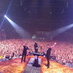 the script while posing at the their gig