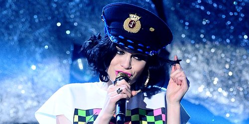 Jessie J wearing a policewoman's helmet