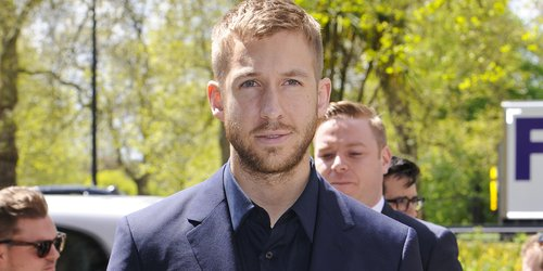 Calvin Harris at the Ivor Novello Awards wearing a suit