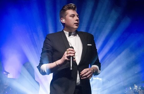 John Newman wearing suit and bowtie