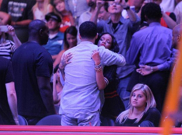 Rihanna and Drake hug at the beasketball