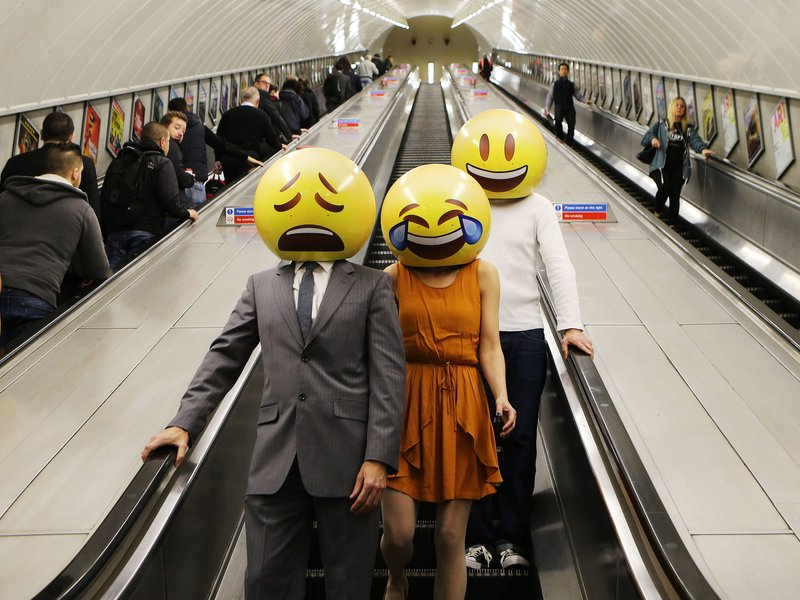 Emoji characters  walking around London