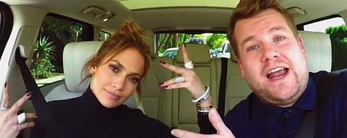Jennifer Lopez and James Corden stood with car