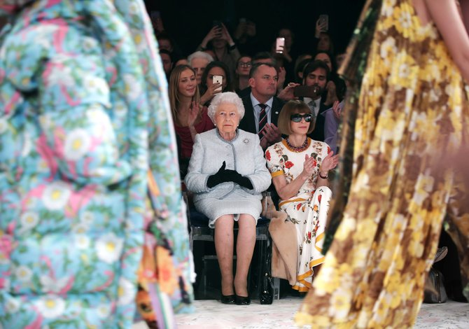 Queen Elizabeth's surprise appearance at London fashion catwalk astonishes participants